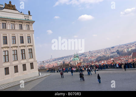 Horizontal wide angle outside Prague Castle with tourists enjoying the elevated view over Prague from Ke Hradu in - Stock Photo