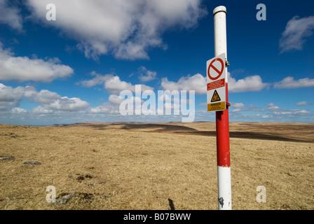 Firing range marker post on Dartmoor, Devon - Stock Photo