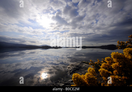 A EARLY MORNING  WITH DRAMATIC SKY VIEW ACROSS LOCH LOMOND IN SCOTLAND.UK - Stock Photo