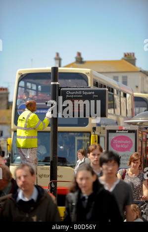 A workman painting a bus stop in Churchill Square, Brighton. Picture by Jim Holden. - Stock Photo