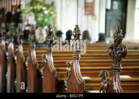 A church with only a few people in the congregation - Stock Photo