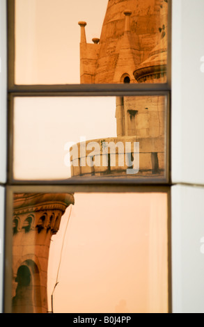 fisherman's bastion reflected on the windows of a nearby building. Budapest - Hungary - Stock Photo