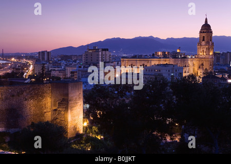 Malaga City, Spain. Cathedral and walls of Alcazaba, sunset - Stock Photo