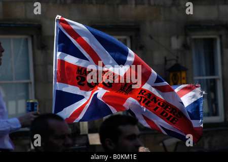 union flag proudly shown by rangers supporters in manchester - Stock Photo