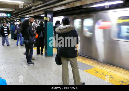 a view of the platform of 59 street subway station - Stock Photo