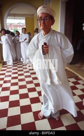 Cao Dai priest. Danang, Vietnam. - Stock Photo