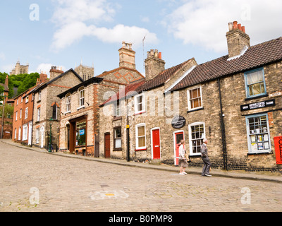 Old shops and houses at the bottom of Steep Hill in Lincoln city, England, UK - Stock Photo