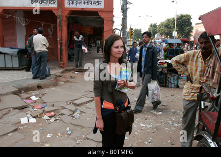 Young female tourist standing at a roadside, India - Stock Photo