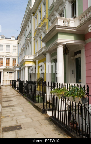 """Georgian large terraced row family house Painted colourfully Chalcot Sq Square """"Primrose Hill""""  London NW1 Uk HOMER - Stock Photo"""