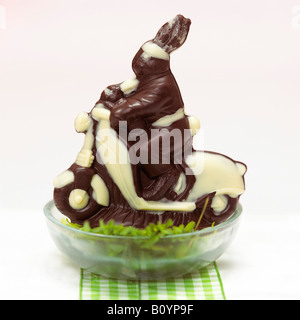 Easter nest with chocolate easter bunny - Stock Photo