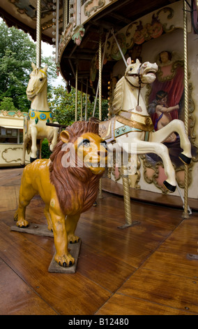 Rides on carousel in city park - Stock Photo