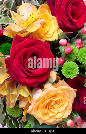 Bunch of Flowers with Red Roses, Yellow Roses, Chrysanthemum, Hypericum and Peruvian Lily (Alstroemeria). - Stock Photo