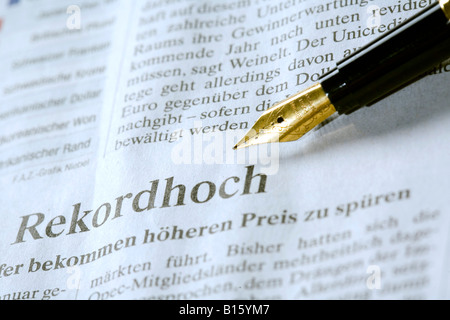 Pen on newspaper, close-up - Stock Photo