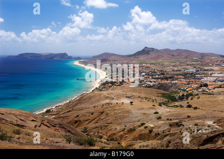 View of the beach and town of Vila Baleira seen from the Portela lookout point on the Portuguese Atlantic island - Stock Photo