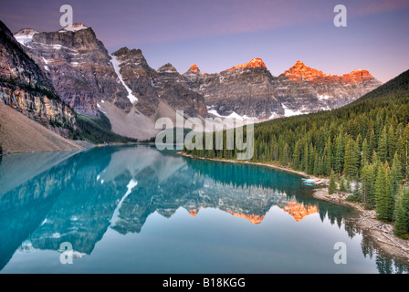 Sunrise at Moraine Lake in the Valley of the Ten Peaks.  Banff National Park, Alberta, Canada. - Stock Photo