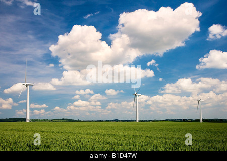 Three wind turbines in a field of wheat against a summer sky on an inshore wind farm in Oxfordshire, England, UK - Stock Photo
