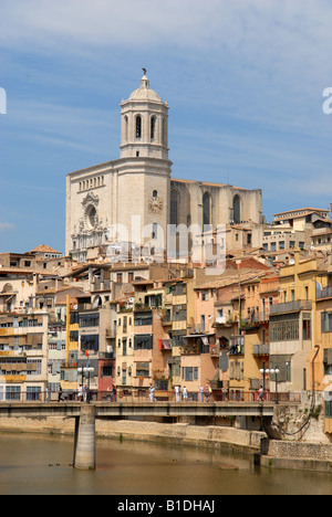 City apartments overlooking the River Onyar with the Cathedral dominating the sky in Girona Spain Europe - Stock Photo