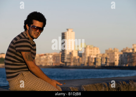 Man in the sunset on the Malecón, Cuba - Stock Photo