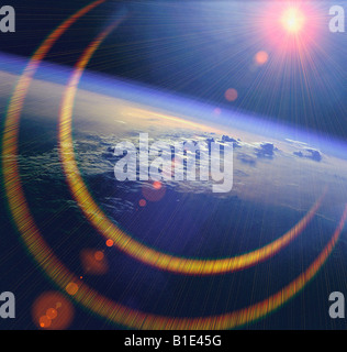 view from NASA shuttle of the earth and sun from outer space - Stock Photo