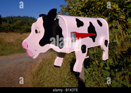 Unusual Whimsical Artistic Folk Art Cow Mailbox on North Pender Island, Southern Gulf Islands, BC, British Columbia, - Stock Photo