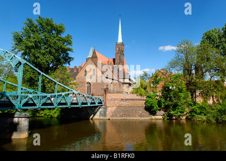Tumski Bridge and Church of the Holy Cross on the river Oder, Wroclaw, Silesia, Poland, Europe - Stock Photo