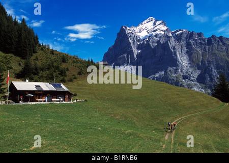 Mountain bikers, Wetterhorn, Grindelwald, Bernese Oberland, Switzerland - Stock Photo