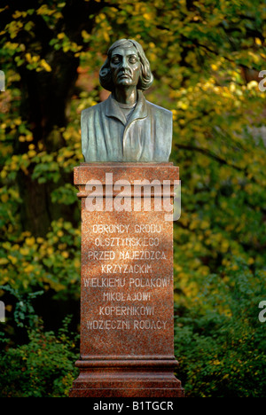 Bust of Nicolaus Copernicus below the former castle of the teutonic order in Olsztyn (Masuria, Poland). - Stock Photo