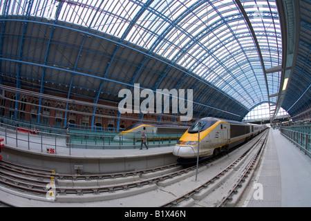 Eurostar trains at platforms in St Pancras Station London England UK United Kingdom GB Great Britain British Isles - Stock Photo