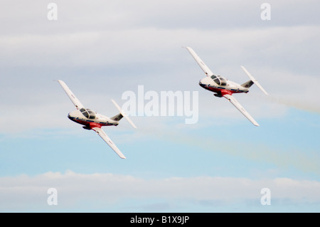 The Snowbirds, Canada's extreme aerobatic team, perform precise maneuvers together in the sky. - Stock Photo