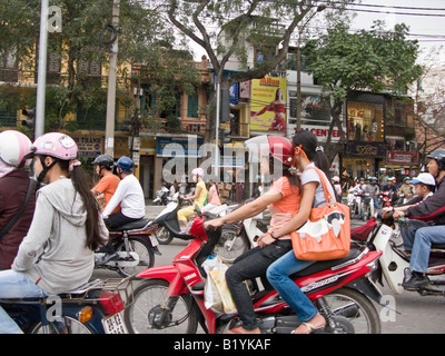 motorbike traffic in busy street in Hanoi, Vietnam - Stock Photo