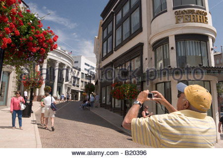 Tourists Taking Pictures at Rodeo Drive Beverly Hills California - Stock Photo
