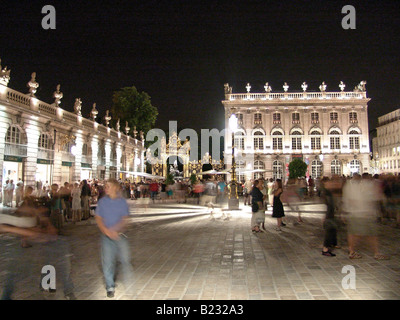 Group of people in front of museum lit up at night Museum of Fine Arts The Place Stanislas Nancy Lorraine France - Stock Photo