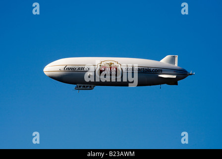 Stella Artois Blimp flying in the sky over London England Uk - Stock Photo