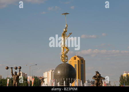 A figure of a performer with an umbrella on the circus fountain in Nur-Sultan or Nursultan called Astana until March - Stock Photo