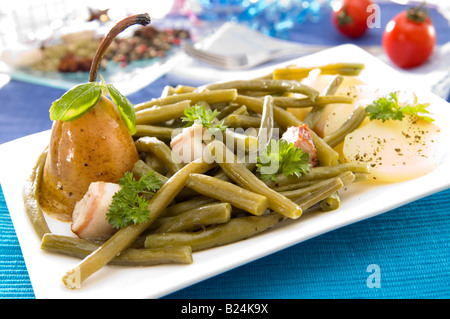 Pears Beans and Bacon served side by side to achieve the preferred mixture of sweet sour salty and smoky - Stock Photo