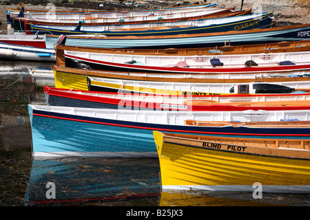 Close up of gig boats lined up in Porthleven harbour, Cornwall UK. - Stock Photo