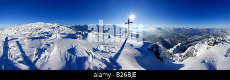Snow-covered mountain scene, panorama from summit of Peterskoepfl, view to Pyramidenspitze in Zahmer Kaiser range, - Stock Photo