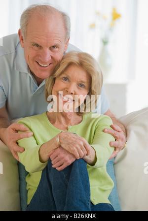 Senior man hugging wife - Stock Photo