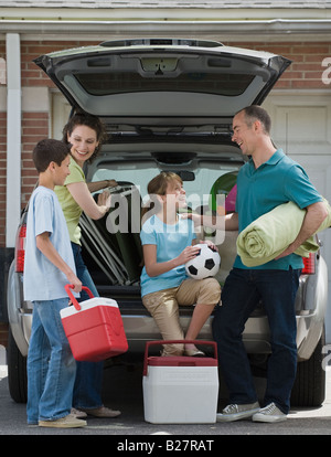 Family packing car for vacation - Stock Photo