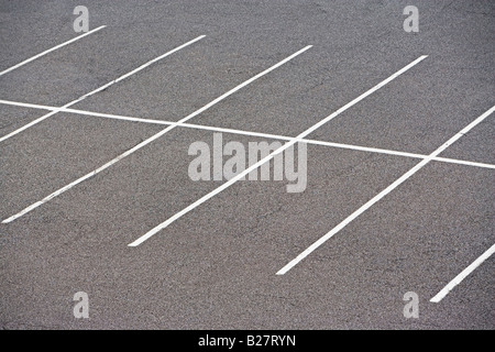 Rows of empty parking spaces - Stock Photo