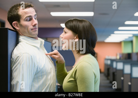 Businesswoman yelling at businessman - Stock Photo