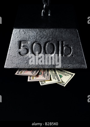 money pressured and squeezed under financial weight - Stock Photo