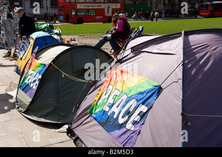 Tenting Camp opposed to British government policies on Parliament Square London UK - Stock Photo