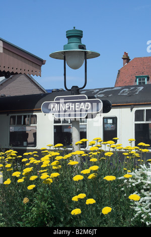 Sign and flowers at Minehead Station. West Somerset Steam Railway. - Stock Photo