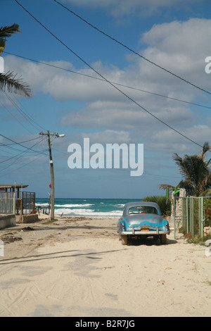 Vintage car parked in front of the Playas del Este Beach Havanna Province Cuba Latin America - Stock Photo