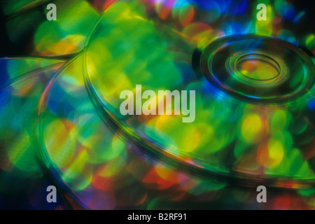 Multi colored stack of cd s reflecting rainbow of colors Marysville Washington State USA - Stock Photo