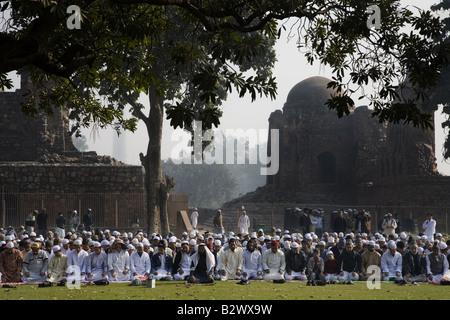 Muslim Devotees offer Eid-ul-fitr prayers at Firoz Shah Kotla mosque, Delhi. - Stock Photo