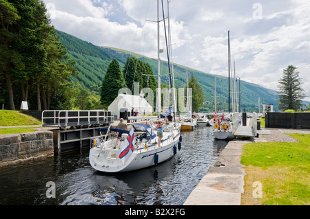 Sailing and motor boats in the process of mooring in the Loch Lochy Laggan locks on the Caledonian Canal in Scotland - Stock Photo