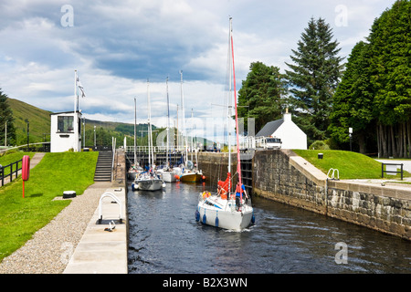 Sailing boats are in the process of leaving the Loch Lochy Laggan locks on the Caledonian Canal in Scotland - Stock Photo