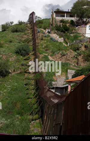 Border fence between Nogales Sonora Mexico (right) and Nogales Arizona (left) - USA - Stock Photo